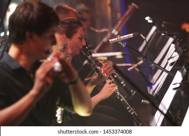 ODESSA, UKRAINE - July 16, 2019: A concert by the symphony orchestra of Andrey Cherny on the theater stage of the Odeskogot Opera Theater. Symphony orchestra musicians perform OSCAR cinematic hits