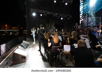 Odessa, Ukraine July 17, 2019: Variety Symphony Orchestra LORDS OF THE SOUND on stage. concert of symphony orchestra on open-air stage.