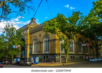 ODESSA, UKRAINE - JULY 2017: National Philharmonic Theatre Building at Street Corner with Blue Sky Background