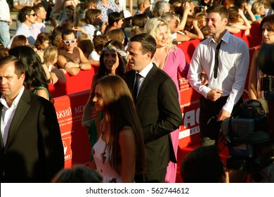 ODESSA, UKRAINE - July 21, 2012: Red carpet opening of International Film Festival in Odessa. Many spectators, audience, paparazzi greeted glamorous celebrity guests. Luxury holiday festive red track