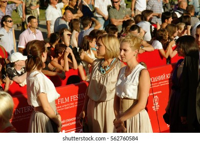 ODESSA, UKRAINE - July 21, 2012: Red carpet opening of  Film Festival in Odessa. Many spectators, audience and paparazzi happily greeted glamorous celebrity guests. Luxury holiday festive red track