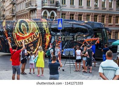 ODESSA, UKRAINE - July 21, 2018: Branded company bus of Shakhtar football club moves to stadium. Enthusiastic fans photograph branded club bus Shakhtar - Donetsk. Football symbols. Club Corporate Bus