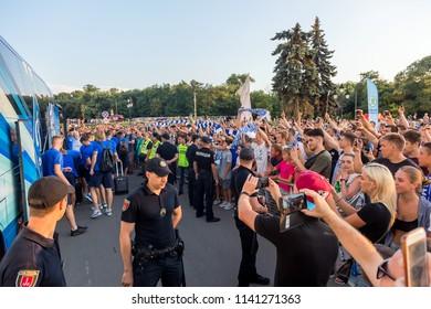 ODESSA, UKRAINE - July 21, 2018: Branded company bus of DYNAMO football club moves to stadium. Enthusiastic fans photograph branded club bus DYNAMO - Kiev. Football symbols. Club Corporate Bus