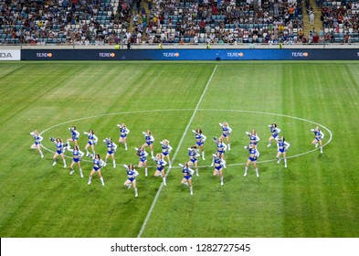 ODESSA, UKRAINE - July 21, 2018: Flashmob with dancing from the support group girls on the field during the finals of the Ukrainian 2018 Supercup, Ukraine