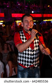 Odessa, Ukraine July 22, 2011: Artist performs songs from stage during concert at nightclub. Artist on clab stage during night party.