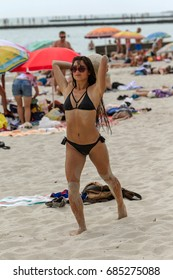 ODESSA, UKRAINE - July 22, 2017: beach football. Holidaymakers on beach are young sports men and women playing beach football in sea. Summer fun vacationers on beach in sand. Selective focus