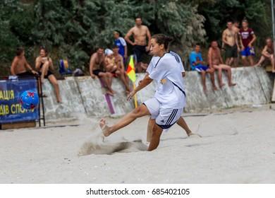 ODESSA, UKRAINE - July 22, 2017: Local Women's Beach Soccer Championship. Beach football on sand. Young beautiful girls play beach football on sand of city beach. Selective focus