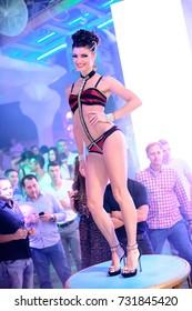 Odessa, Ukraine July 25, 2014: Ibiza night club. Go go dancer. Dance show at night club. Performance show during night party.