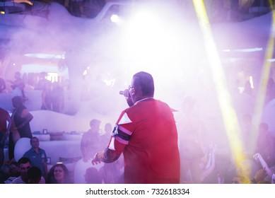 Odessa, Ukraine july 26, 2015: Ibiza club. MC on club stage during night club party. Night party on beach open air club.