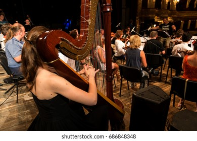 """ODESSA, UKRAINE - July 26, 2017: Orchestra on stage. Musical show """"Battle of the Orchestras."""" Musicians of symphonic variety orchestra, musical instruments. Jazz Orchestra on stage. Selective focus"""