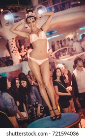 Odessa, Ukraine July 4, 2015: Ibiza night club Go go dancer. Dance show at night club with lights show and club smog. Performance show during night party.