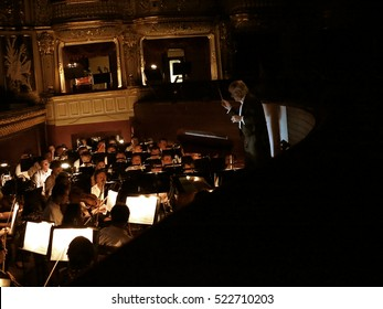ODESSA, UKRAINE - July 6 2013: The orchestra pit with the score, notes, musical instruments and performers during the performance of choreography at the National Theatre of Opera and Ballet