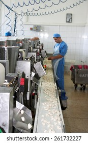 Odessa, Ukraine - July 7, 2007: The factory for the production of food from natural Ingredients. Food Convenience food. Production of dumplings, pancakes. Preparation of filling. Motion Blur.