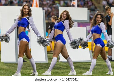 ODESSA, UKRAINE - July28, 2019: Performance of beautiful young girls cheerleader team during opening of football championship. Team performance cheerleader on grass field stadium. Girls of cheerleader