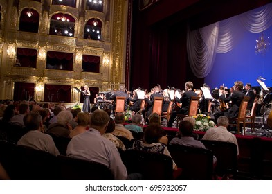 "Odessa, Ukraine -  June 09, 2013: The interior of the theater arts. The auditorium with seats and balcony. ""International Festival of Arts"" in the Odessa National Theater of Opera and Ballet."