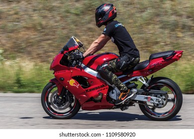 ODESSA, UKRAINE - June 10, 2018: Motorcycle racing. Dynamic and realistic racing motorcycles on race track. Unique motorcycles, extreme shoi, smoke from heating of wheels, drift at site