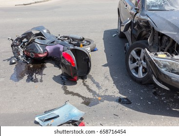 ODESSA, UKRAINE - June 12, 2017: Car collision. Automobile accident Toyota Lexus and motorcycle Honda collided on city street. Collision of bike with jeep Lexus at crossroads of city road
