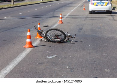 ODESSA, UKRAINE - June 13, 2019: Fatal accident car with a bicycle on a high-speed highway. Ricked bike after colliding with a car. Road accident on a city road