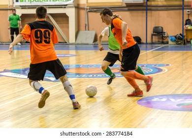 Odessa, Ukraine - June 2, 2015: Unidentified players local teams playing in  tournament of mini-football in futsal on parquet floor. Poor lighting in an inexpensive futsal. Men spend leisure, Hobbies
