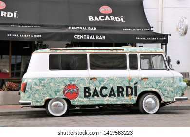 Odessa, Ukraine. June 2019. Adversiting car / mini van, with a Bacardi sponsor. Located in front of a club called Bacardi central bar.