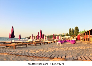 Odessa, Ukraine. June 2019. Panoramic view of one of the most beautiful beaches of Odessa. Called Lanzheron beach. Sandy beach of the Black sea. In the background is visible some building of the city.