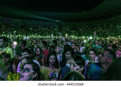 Odessa, Ukraine -June 25, 2016: crowd of spectators at  rock concert during  creative light and music. Crowds and queues of people on face-control, spectators in stands. People relaxing and having fun
