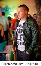 Odessa, Ukraine June 26, 2015: Ibiza club. People smiling and posing on cam during concert in night club party. Man have fun at club. Boy at night club party