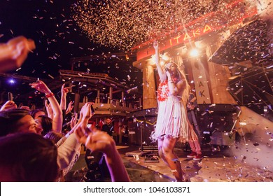 Odessa, Ukraine June 3, 2016: Artist performs songs from stage during concert at nightclub. Artist on club stage during night party.