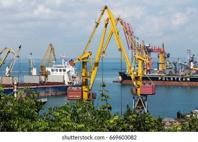 ODESSA, UKRAINE - June 30, 2017: Black Sea Trade Port, loading containers with a crane. International shipping. Container export logistics, port views, water transport. Industrial transportation
