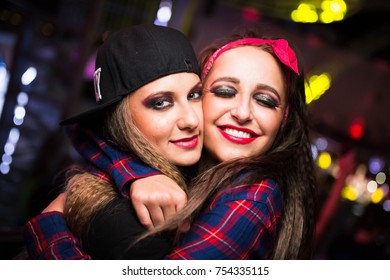 Odessa, Ukraine June 5, 2014: Bono beach club. Women smiling and posing on cam during concert in night club party. Girl have fun at club. girl at night club party