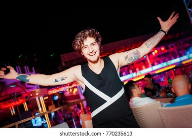 Odessa, Ukraine June 5, 2014: Itaka naght club. People smiling and posing on cam during concert in night club party. Man have fun at club. Boy at night club party
