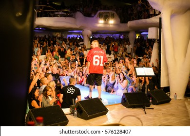 Odessa, Ukraine June 5, 2015: Concert famous rapper Basta, label gazgolder performs songs from stage during concert club. Many audience on rap show.