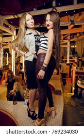 Odessa, Ukraine June 5, 2015: Itaka night club. Women smiling and posing on cam during concert in night club party. Girl have fun at club. girl at night club party