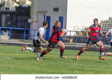 ODESSA, UKRAINE - June 5, 2016: European Championship of rugby CREDO - Odessa (red) and the White Wolfs -Moldova (white). Tense moment scrum during the match of men. Game time rugby scrum