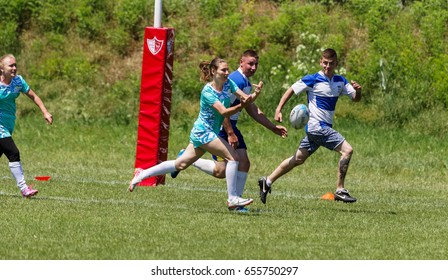 ODESSA, UKRAINE - June 5,2017: Friendly matches of women and men's rugby teams. Moment of struggle during match between girls and boys. Dramatic tough game for women in rugby against men.
