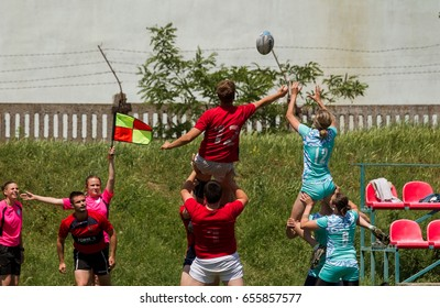 ODESSA, UKRAINE - June 5,2017: Friendly matches of women and men's rugby teams. Moment of struggle during match between girls and boys. Dramatic tough game for women in rugby against men. White angels