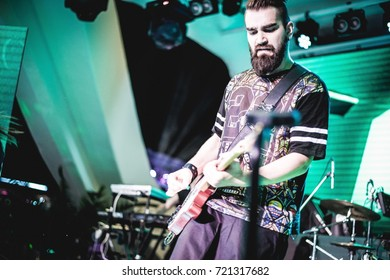 Odessa, Ukraine June 6, 2014: Ibiza night club. THE HARDKISS Artist performs songs from stage during concert at nightclub. Artist on club stage during night party with lights show and club smog.