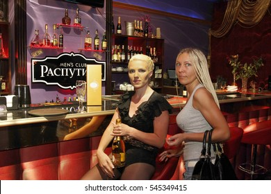 ODESSA, UKRAINE - June 6, 2015: The bar with expensive drinks and waitresses in night strip club. Men's clubs showing striptease gaining popularity during the crisis in the country. Striptease bar