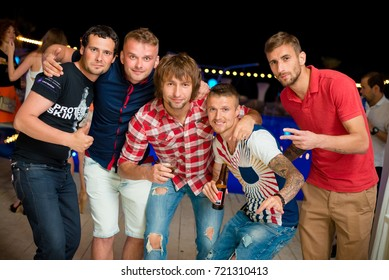 Odessa, Ukraine June 6, 2015: Ibiza night club. People smiling and posing on cam during concert in night club party. Man and woman have fun at club. Boy and girl at night club party