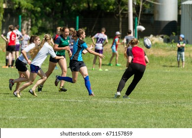 ODESSA, UKRAINE - June 6, 2017: brutal rugby fight between women's teams. Girls Players assiduously grasp opponents in the fight for the ball in the rugby cup. Rugby women seize each  ball
