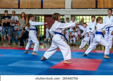 ODESSA, UKRAINE - June 7, 2015: Karate Tournament Streda children and adolescents. The battle on mat karatekas. Children, boys and girls making their first steps in learning the art of martial arts