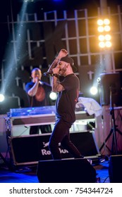 "Odessa, Ukraine June 8, 2014: Bono beach club. Famous Russian Artists L""One and MOT performs new club show songs from stage during concert at nightclub. Artist on club stage during night party"
