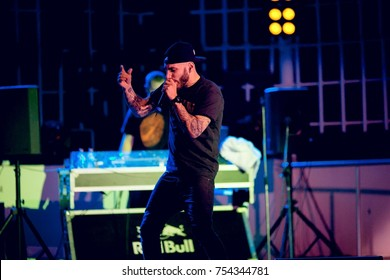 """Odessa, Ukraine June 8, 2014: Bono beach club. Famous Russian Artists L""""One and MOT performs new club show songs from stage during concert at nightclub. Artist on club stage during night party"""