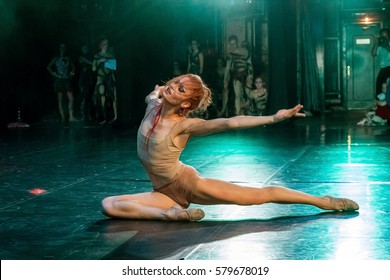 """Odessa, Ukraine -June2,2013: Actors at dress rehearsal of ballet """"Sacred Spring"""" on stage of Ballet Theatre. Dancers in color costumes during show moving. Take look behind scenes. Creative Motion Blur"""