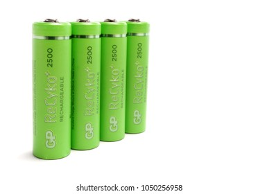 ODESSA, UKRAINE - MARCH 13, 2018: Four GP ReCyko+ 2500 series AA rechargeable batteries in perspective row. Gold Peak Group (Hong Kong)  GP Batteries product.