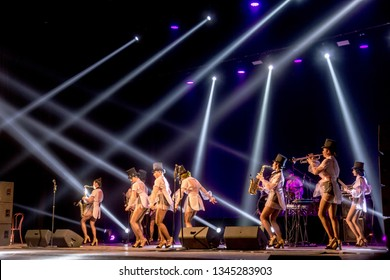 ODESSA, UKRAINE - MARCH 17, 2019: Bright music show FREEDOM JAZZ. Beautiful female jazz band on stage in a bright musical jazz show. Sexy women musicians on stage in an erotic musical performance