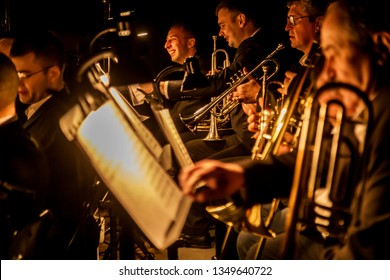 ODESSA, UKRAINE - March 23, 2019: Symphony orchestra concert on theater stage. Musicians of State Symphony Orchestra, instruments of symphony orchestra on stage. Score, sheet music during concert