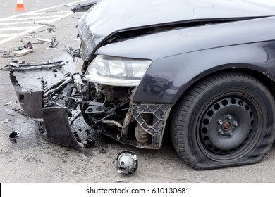 ODESSA, UKRAINE - MARCH 27, 2017: Car accident in city center. Broken car, the engine oil leaked, wheel burst.