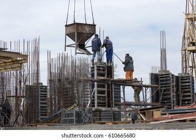 ODESSA, UKRAINE - MARCH 27, 2017: Construction site of modern high-rise building. Building landscape, interior of construction of high-rise apartment house. Construction machinery at construction site