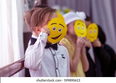 ODESSA, UKRAINE - March 8, 2017: Children at concert in primary school. Skit. Children's theatrical creativity, amateur performance in kindergarten congratulate mothers on Women's Day, Mother's Day
